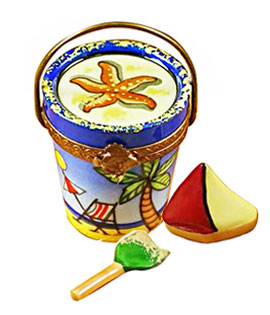 Limoges box beach pail with shovel and toy boat