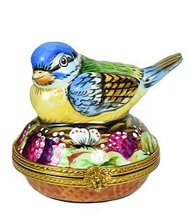 Limoges box colorful bird on nest with porcelain egg inside