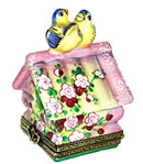 Limoges box birdhouse with birds on top and two chicks inside