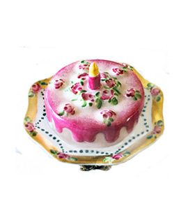 Limoges box pink birthday cake with candle on elegant plate