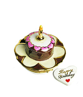 small chocolate and cream Limoges box birthday cake on plate