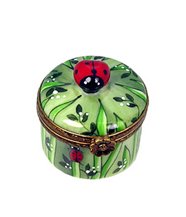 small round Limoges box with ladybugs and grass