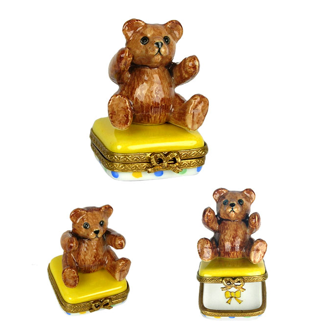 small teddy bear limoges box on colorful base