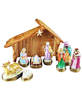 Rochard Limoges boxes - eight nativity figures with porcelain stable