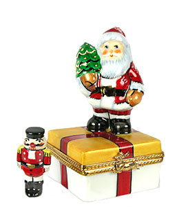 Rochard Santa on gift with nutcracker Limoges box