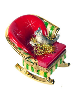 Limoges box cat in rocking chair with holiday tinsel