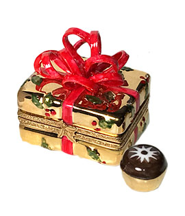 gold gift with red bow Limoges box with chocolate inside