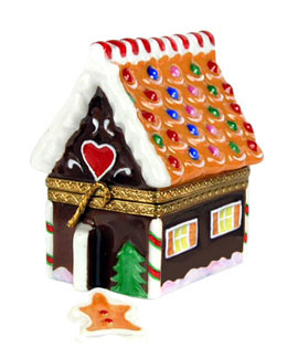 Limoges box gingerbread house with candy trim and gingerbread man