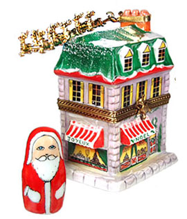 tall house with sleigh overhead and Santa figure Limoges box