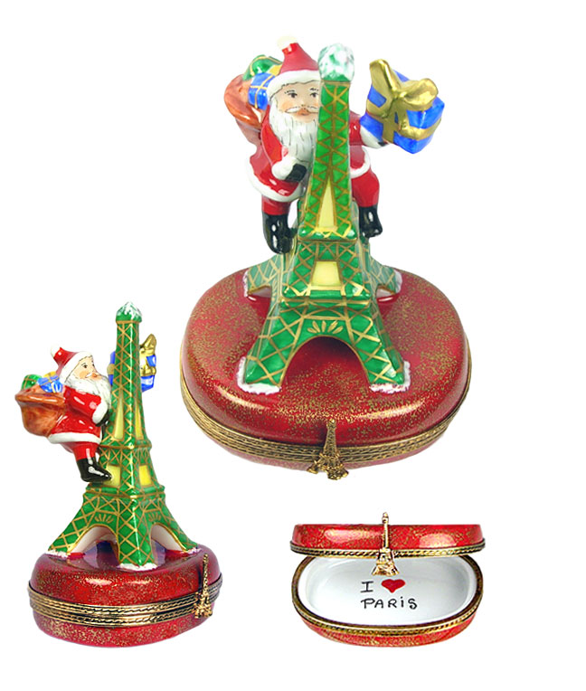 Santa climbing Eiffel Tower with gift Limoges box