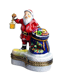 Limoges box Santa holding lantern with pack of toys