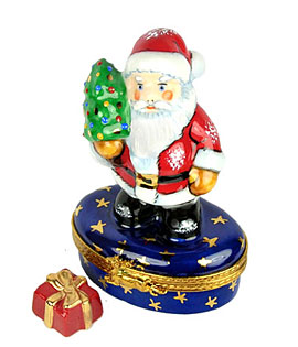 Santa with tree Limoges box on gold stars base