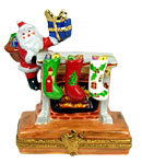 santa with gift at fireplace limoges box