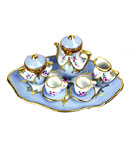blue teaset with two limoges boxes