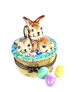 Limoges box basket of bunnies with colored eggs