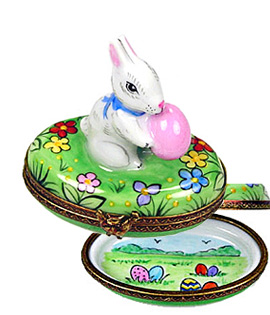 Limoges box bunny holding pink egg