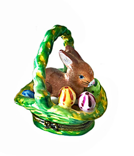 brown bunny with eggs in green Limoges box basket