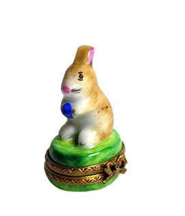 Limoges box small rabbit holding colored egg