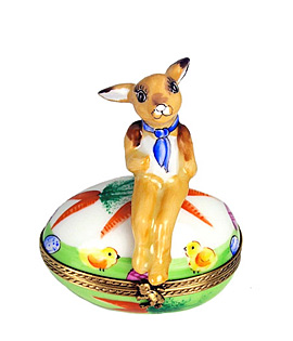 Limoges box rabbit seated on decorated egg