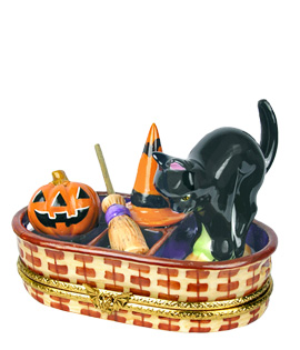wicker basket with cat, jack-o-lantern, witch hat and broom