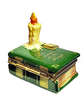 Limoges box book of magic secrets with burning candle
