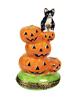 Limoges box cat on stack of Jack o lantern pumpkins