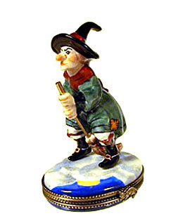 Limoges box witch wearing green dress on broom
