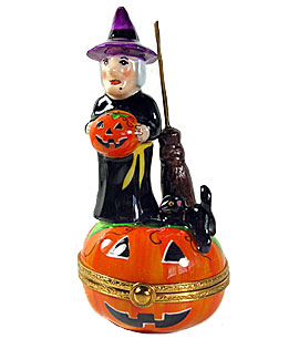 Limoges box witch standing on Jack o lantern with cat