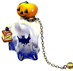 Halloween pumpkin head ghost with ball and chain
