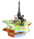 artist painting Eiffel Tower on French map