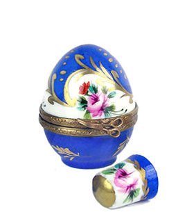 Small egg Limoges box holding thimble