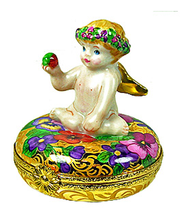 sweet cherub on gold and panises Limoges box