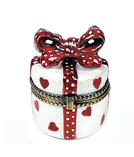 round gift with hearts decor and bow