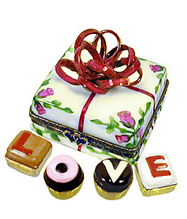 candy box with bow Limoges box with truffles spelling L-O-V-E