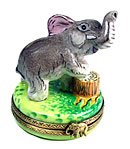 Limoges box elephant with leg on stump